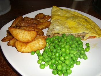 Fresh out of a chicken's bum omelette, jacket wedges and peas