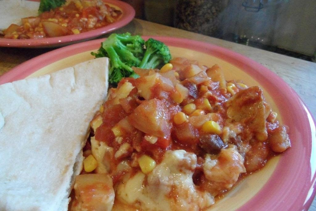 Slow cooked bean, potato and cheese stew
