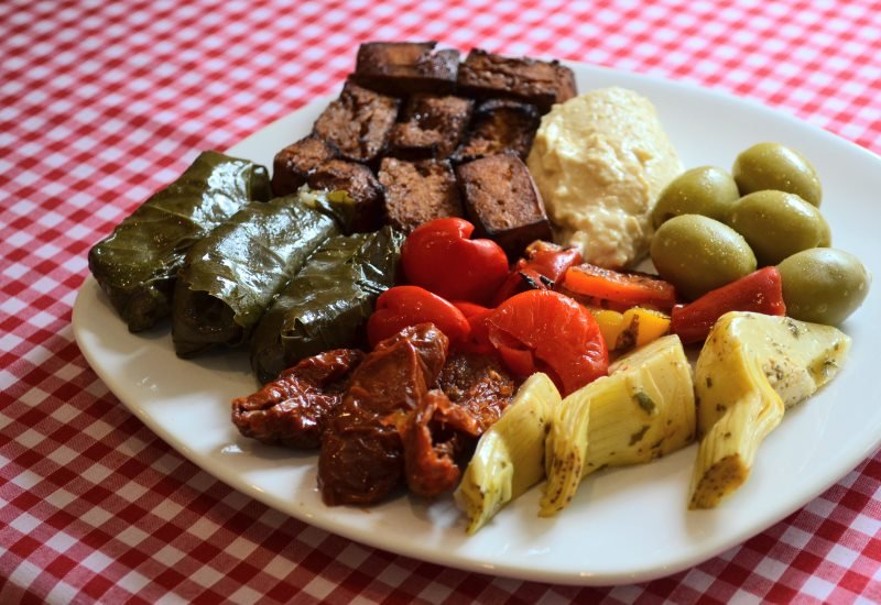 stuffed vine leaves, sundried tomatoes, artichoke hearts, olives, tofu, hummus, roasted peppers