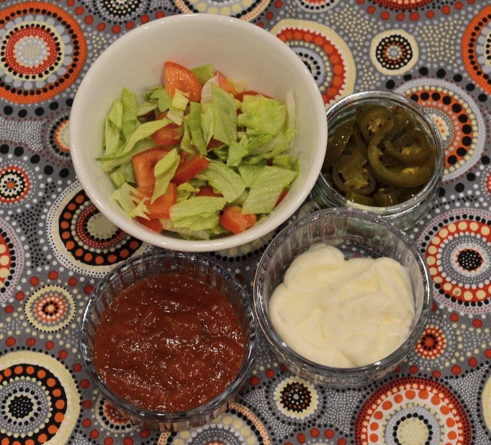 Salad, jalapenos, salsa and sour cream topping