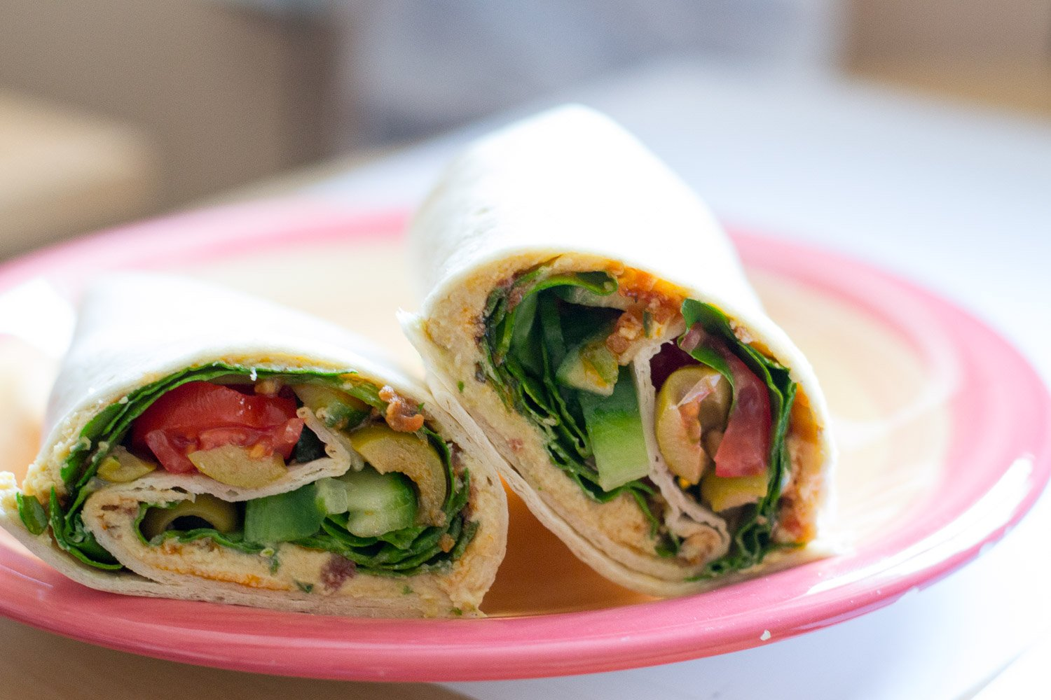 Vegan salad wrap with sundried tomato paste