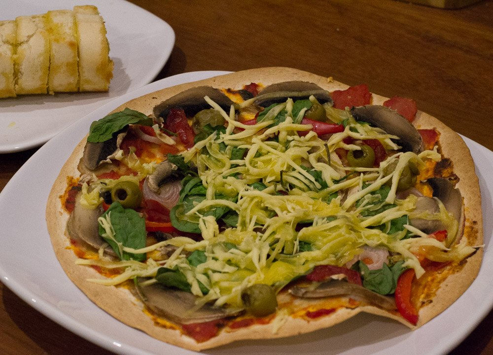 Tortilla pizza with Violife vegan cheese