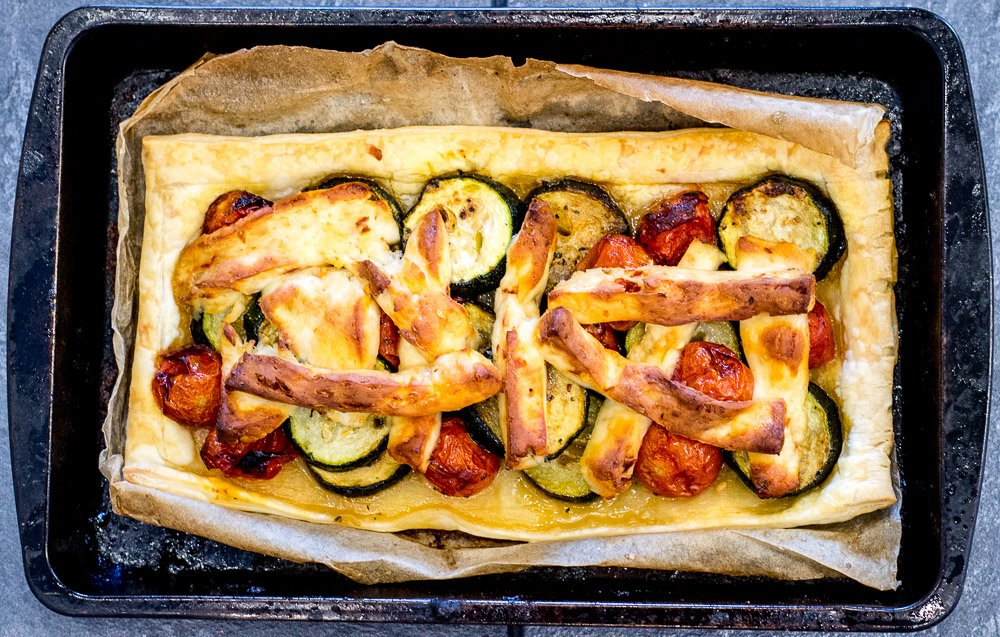 Courgette, cherry tomato and halloumi tart
