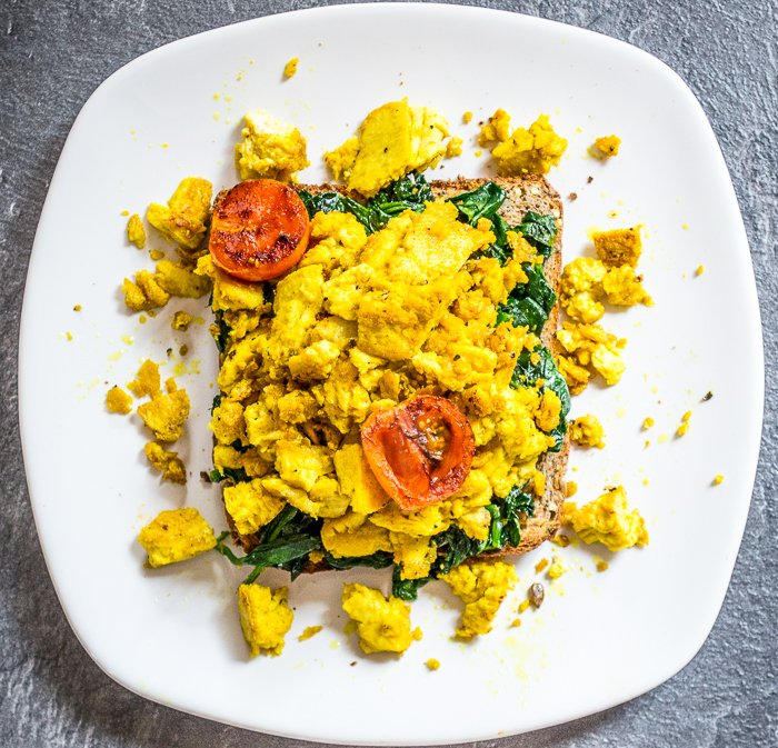 vegan tofu scramble with spinach on wholemeal toast