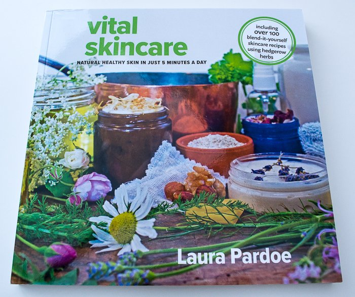 Book - Vital Skincare by Laura Pardoe. It's a softcover book with jars of ingredients and flowers and herbs on the cover.